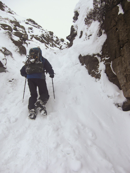 G bravely forcing a way up most extreme line of snow steps. Copyright Haydn Williams 2010