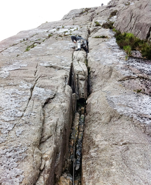 Starting up Ordinary Route (Diff). Climber at the top is just about the belay I'm heading for. Copyright Haydn Williams 2011. Photo by Gary Mirams.