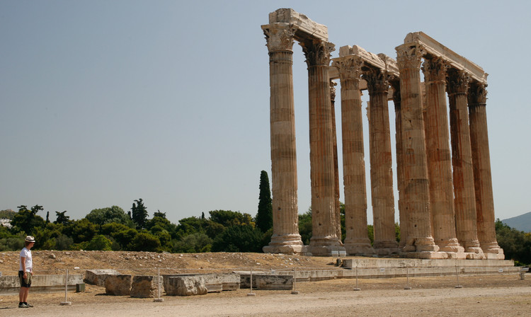 Nick inspects the corinthian columns of the Temple of Olympian Zeus. Copyright Haydn Williams 2011
