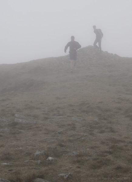 Arno and Rob hit the first summit of the day - Y Garn on the Nantlle ridge. © Haydn Williams 2012