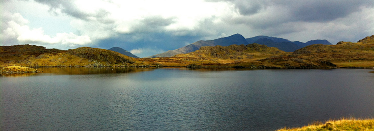 Snowdon Massif from Llyn yr Adar. The far skyline was our route the previous day.  Haydn Williams 2012