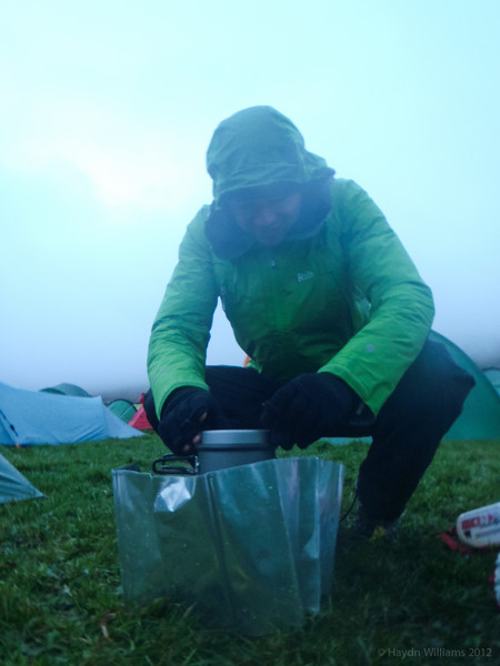 Greg valiantly brews up for breakfast in the rain.  Haydn Williams 2012