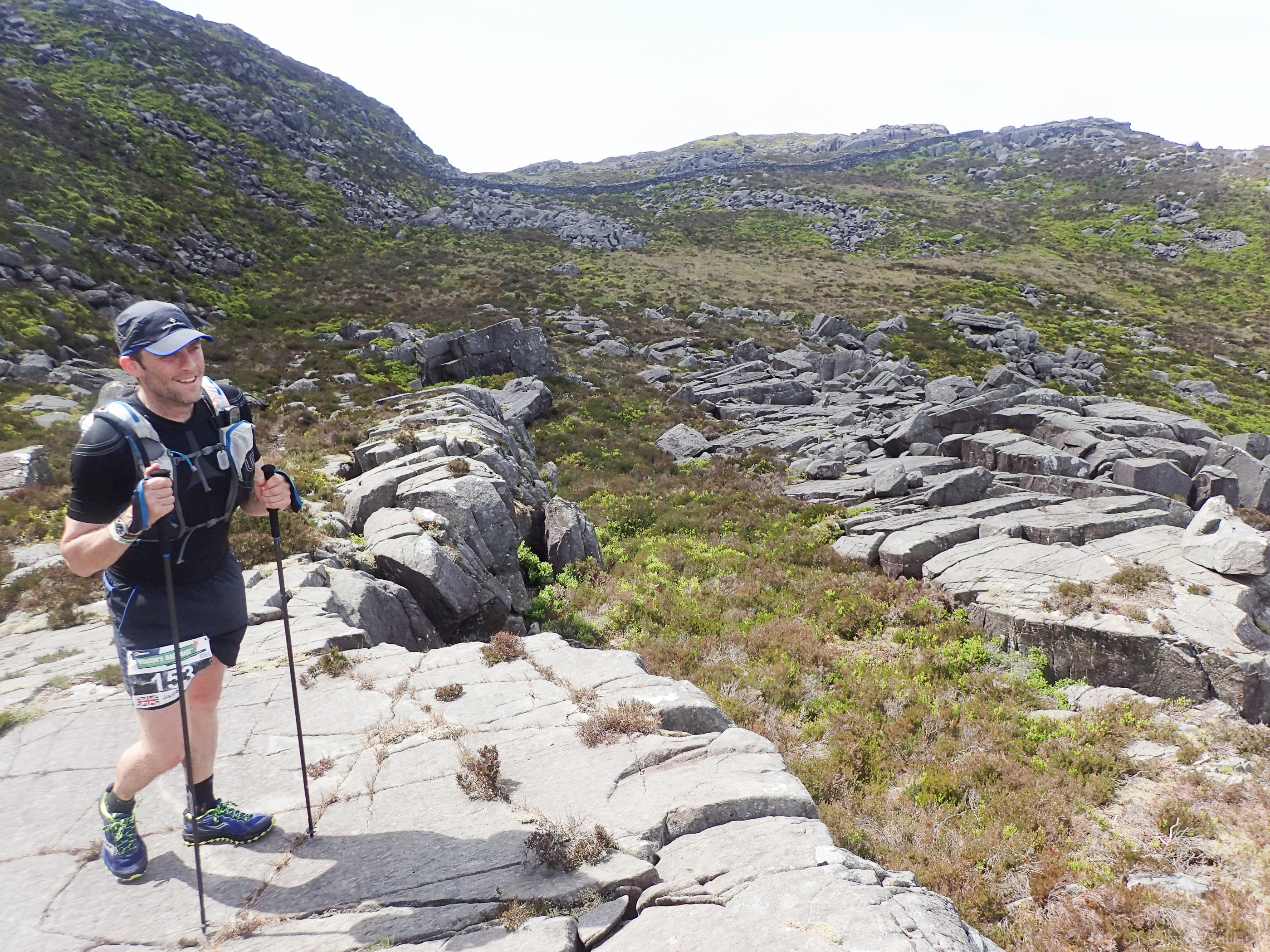 Day 2 - James McGinn pauses to look back at the route so far on Rhinog Fawr. ©Haydn Williams 2017