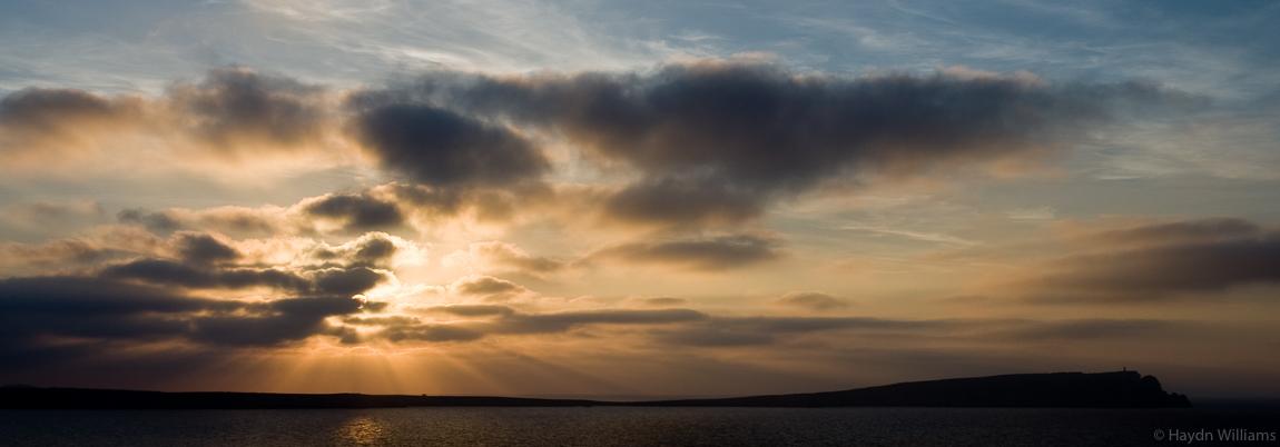 Evening sun over Cap de Cavalleria and lighthouse, Menorca. © Haydn Williams 2008