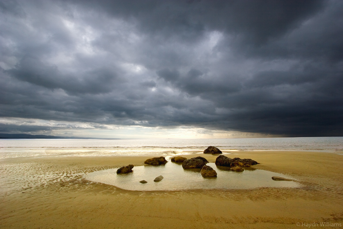 Storm clouds over Criccieth Beach. © Haydn Williams 2006