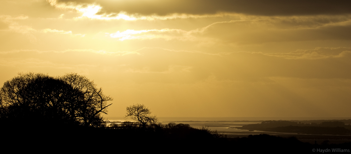 Sunset over the Menai Straits and Anglesey. © Haydn Williams 2004