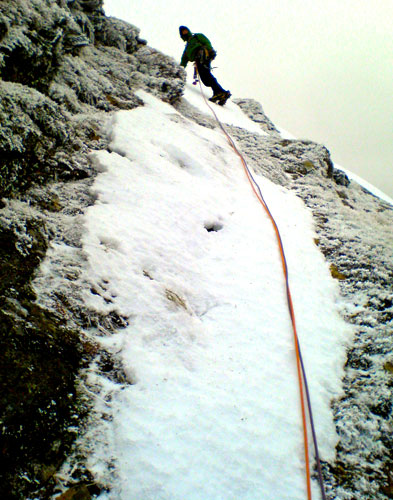 Hamish topping out on Taxus Icefall Finish (IV, 4).