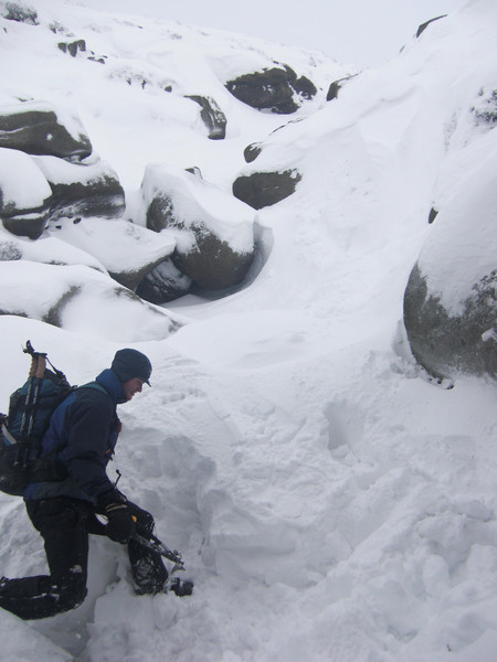"Playing ""Guess what's solid and what's covering a 5ft hole"" in Crowden Clough. Copyright Haydn Williams 2010"