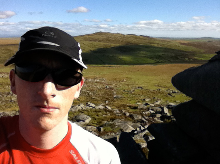 On top of Rough Tor. Brown Willy, highest point in Cornwall, behind. Copyright Haydn Williams 2010
