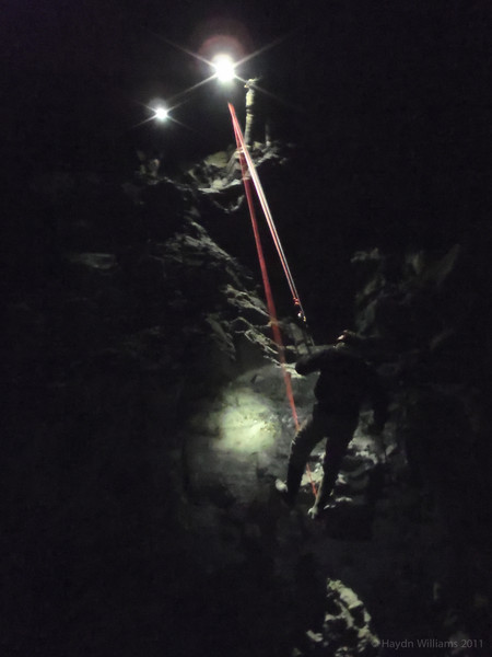 James abseiling down to the chamber floor. © Haydn Williams 2012