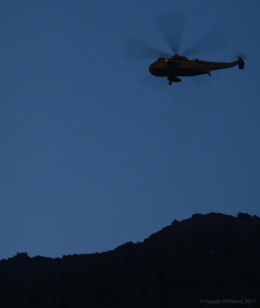 The RAF Sea King about to despatch a winchman to an injured climber below Crib Goch. © Haydn Williams 2012