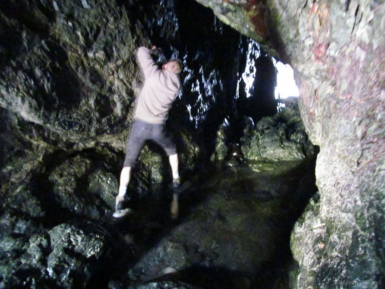 Gareth avoiding the big puddle in the cave at Mullion Cove. © Haydn Williams 2013