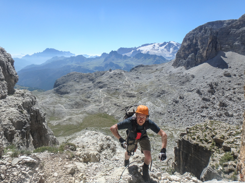 Alex atop Piz de Lech via ferrata. Ignore the fact he's not actually clipped to anything; it's not a *huge* drop. Honest. © Haydn Williams 2016