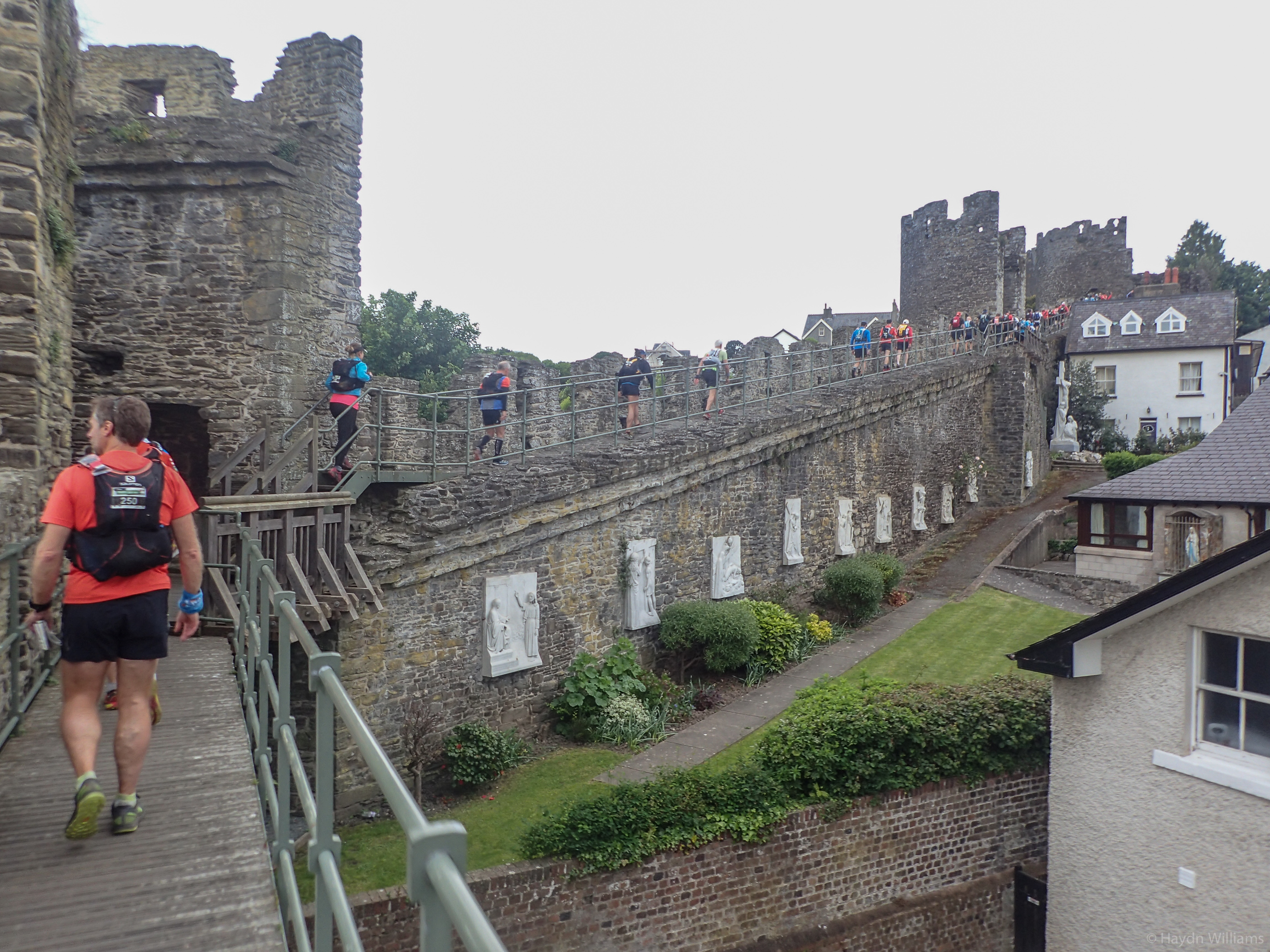 Day 1 - Runners leave Conwy by the castle walls. © Haydn Williams 2017
