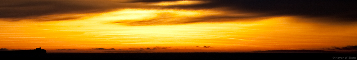 "Sunrise over the Farne Isles. Another one from my still-unfinished ""Lighthouse"" series. © Haydn Williams 2008"